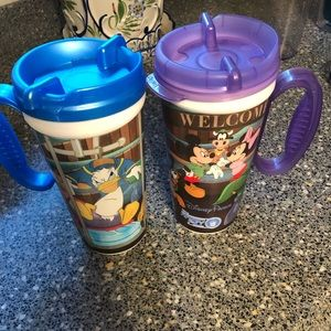 "Two Disney ""refillable"" mugs"